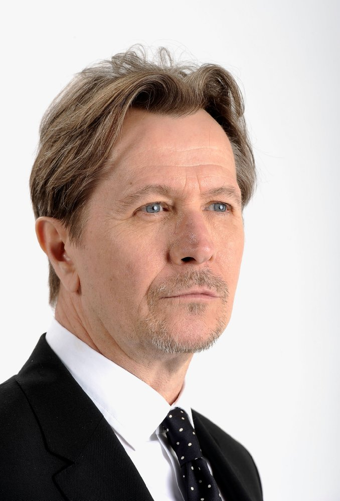 Gary Oldman in a suit