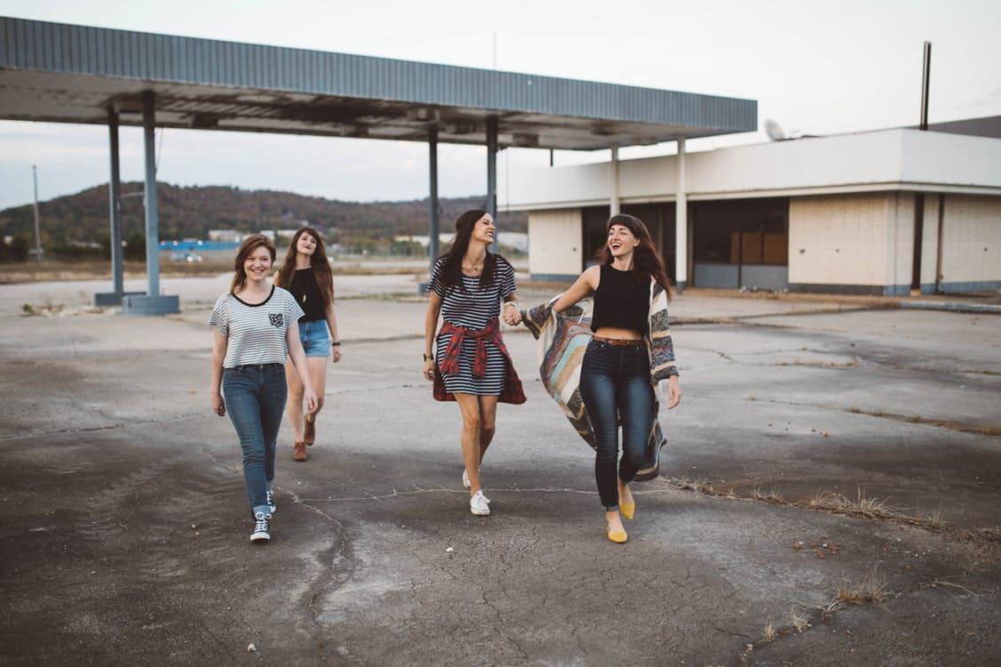 Group of young women in a parking lot